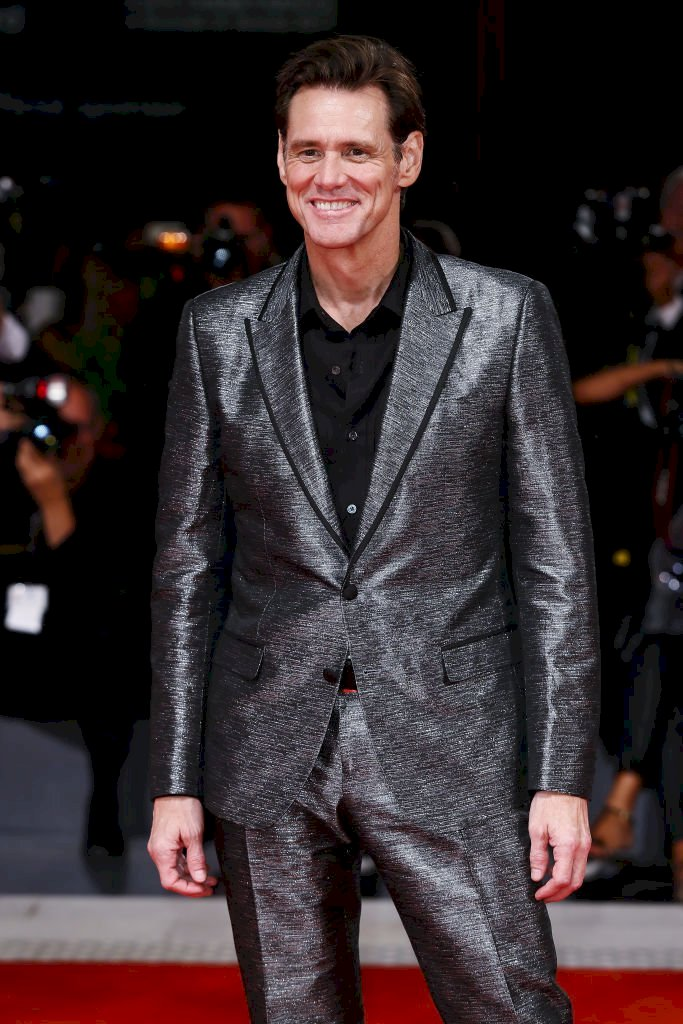 """Image Credits: Getty Images / Jim Carrey walks the red carpet ahead of the """"Jim & Andy: The Great Beyond"""""""