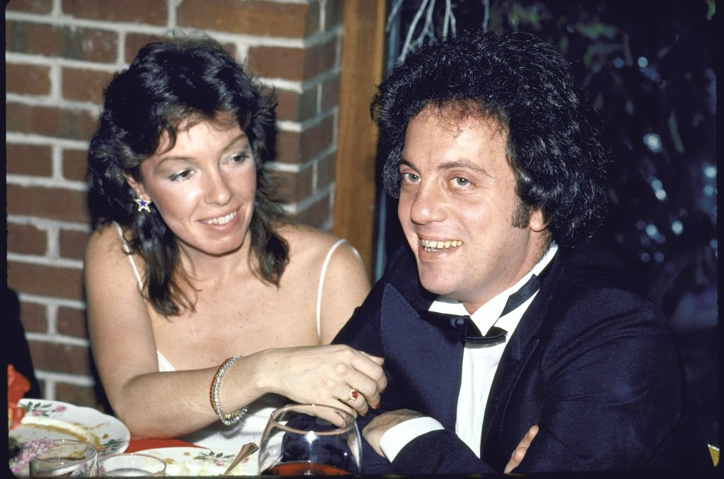 Image Credits: Getty Images / David Mcgough / DMI / The LIFE Picture Collection | Singer/songwriter Billy Joel and wife Elizabeth.