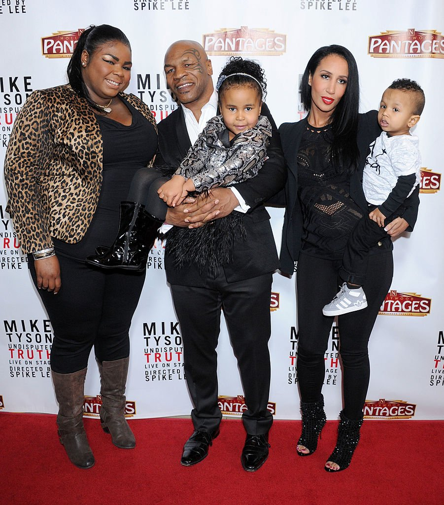 """Image Source: Getty Images/Gregg DeGuire/Mike Tyson (C), daughters Mikey Tyson, Milan Tyson, wife Kiki Tyson and son Morocco Tyson arrive at the Los Angeles opening night of """"Mike Tyson - Undisputed Truth"""" at the Pantages Theatre on March 8, 2013 in Hollywood, California"""