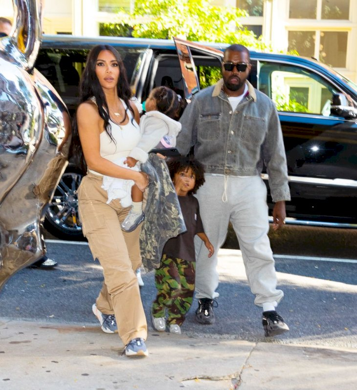 Image Credit: Getty Images / The Kardashian-West family are snapped by paparazzi.