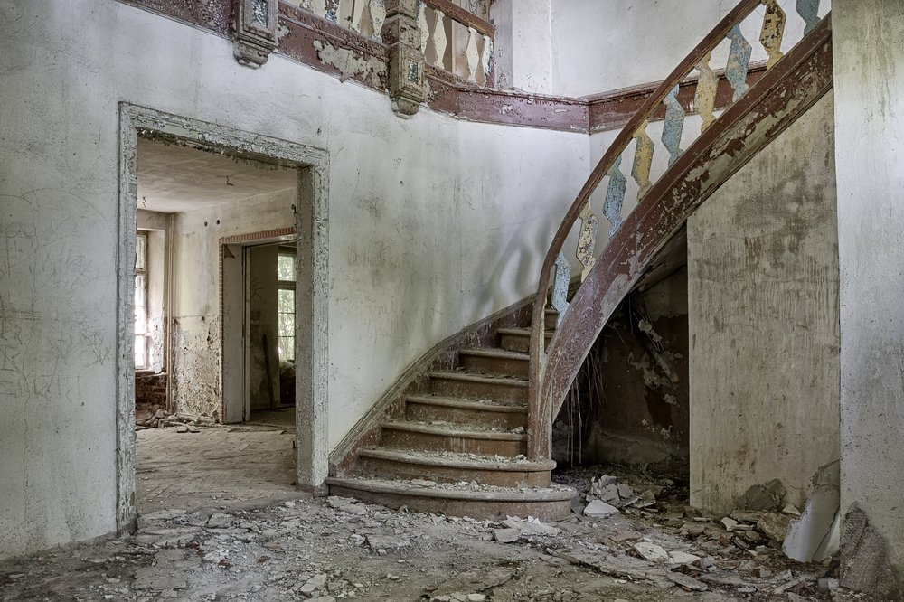 The interior of an abandoned mansion | Shutterstock