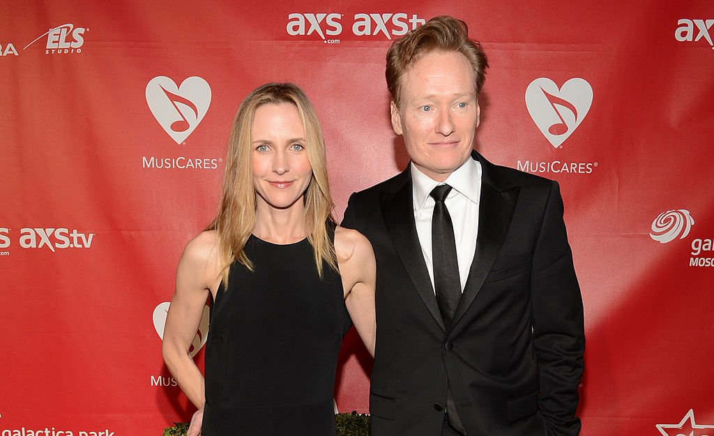 Image Source: Getty Images/Getty Images for NARAS/Larry Busacca | O'Brien and his wife at a red carpet event