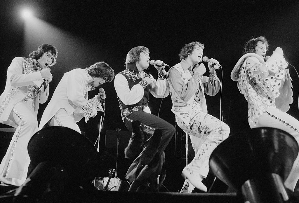 Image Credit: Getty Images / American pop group The Osmonds performing at Earls Court, London, 29th May 1975.