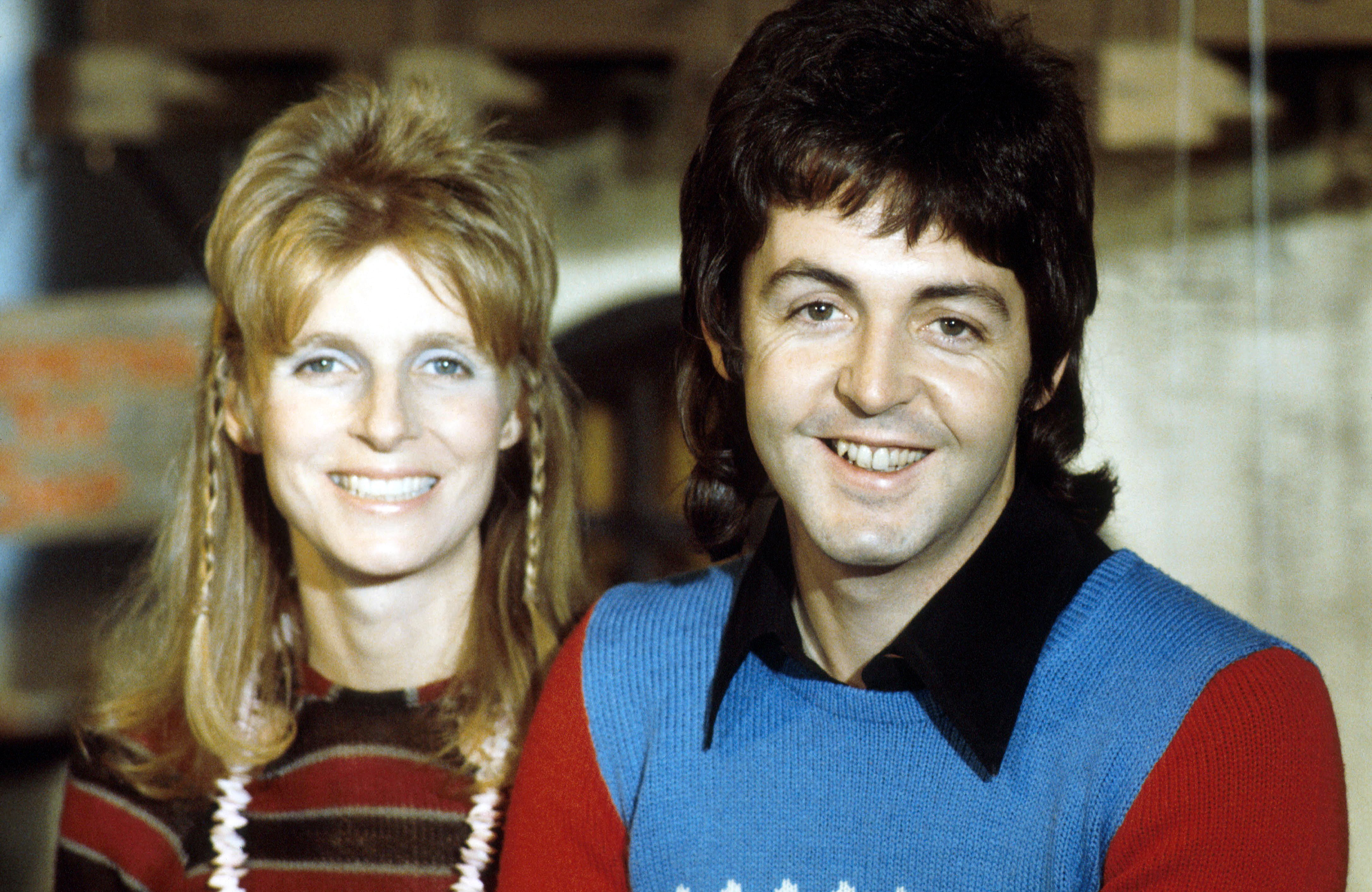 Image Credits: Getty Images / Michael Putland | Linda McCartney (1941 - 1998) and husband Paul McCartney of Wings posed in 1973.