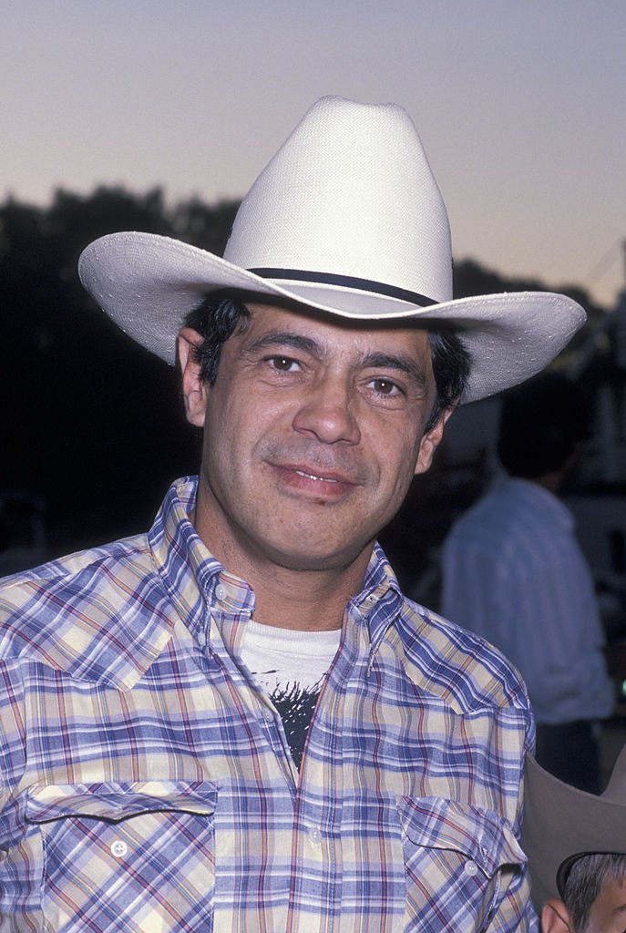 "Image Credits: Getty Images / Ron Galella, Ltd. / Ron Galella Collection | Actor Reni Santoni attending ""Ben Johnson Pro-Celebrity Rodeo Party"" on August 11, 1989 at the Los Angeles Equestrian Center in Los Angeles, California."