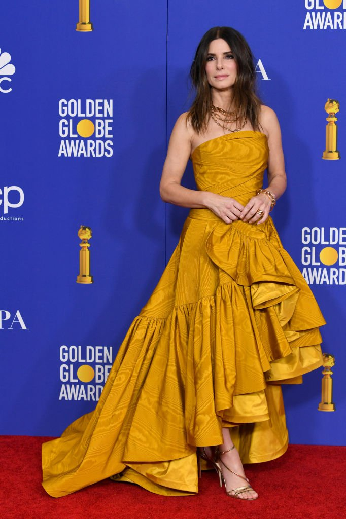 Image Credits: Getty Images / Kevin Winter | Sandra Bullock poses in the press room during the 77th Annual Golden Globe Awards at The Beverly Hilton Hotel on January 05, 2020 in Beverly Hills, California.