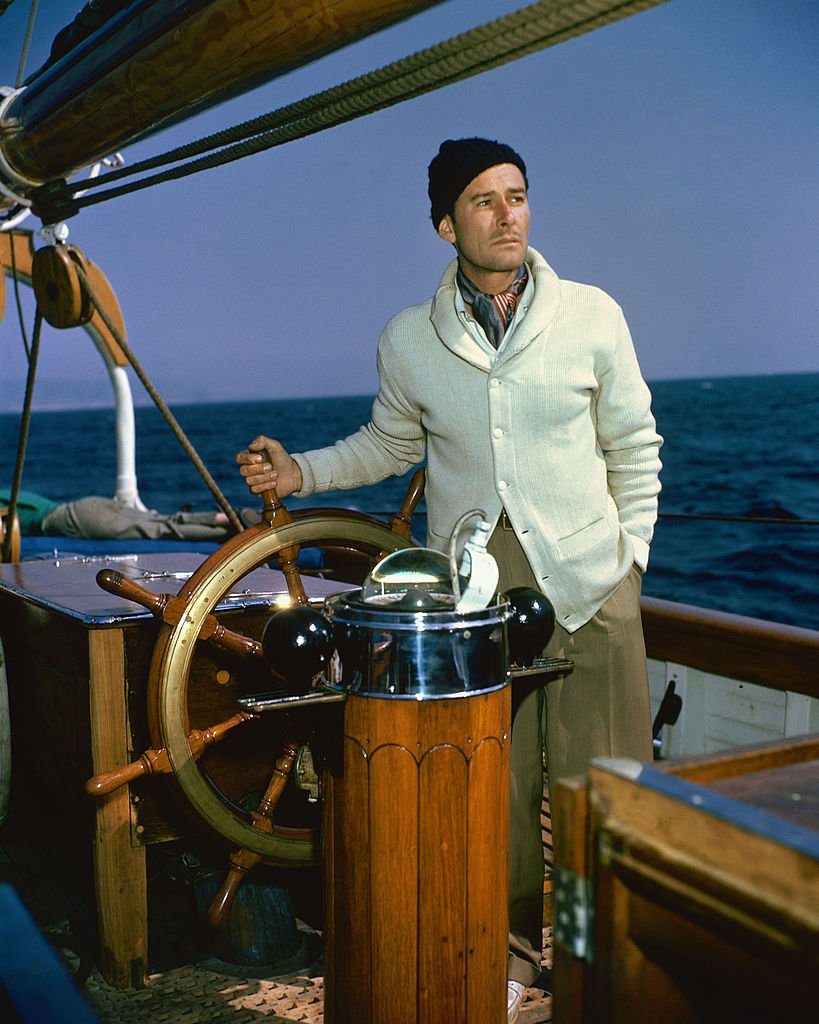 Image Source: Getty Images/Silver Screen Collection/Errol Flynn (1909-1959), Australian actor, at the wheel of his schooner, 'The Zaca', in a publicity still issued for the film, 'Cruise of the Zaca', 1952