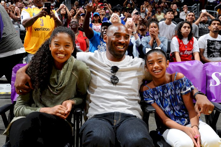 Image Credits: Getty Images / Juan Ocampo / NBAE | NBA Legend Kobe Bryant attends a WNBA game between the Phoenix Mercury and the Los Angeles Sparks with his daughters on June 18, 2017 at STAPLES Center in Los Angeles, California.