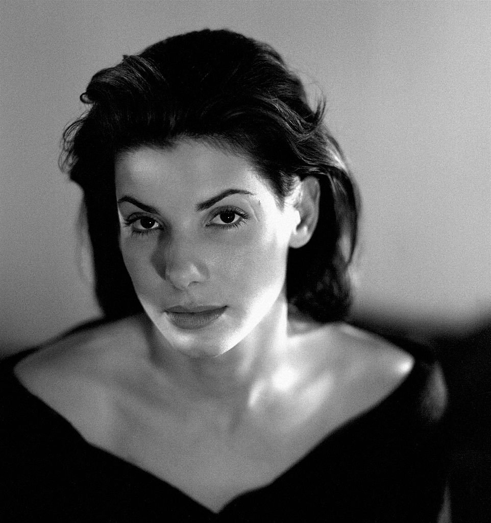 Image Credits: Getty Images / Michael Tighe / Donaldson Collection | Actress Sandra Bullock poses for a photo shoot in 1993 at her residence in Los Angeles, California.