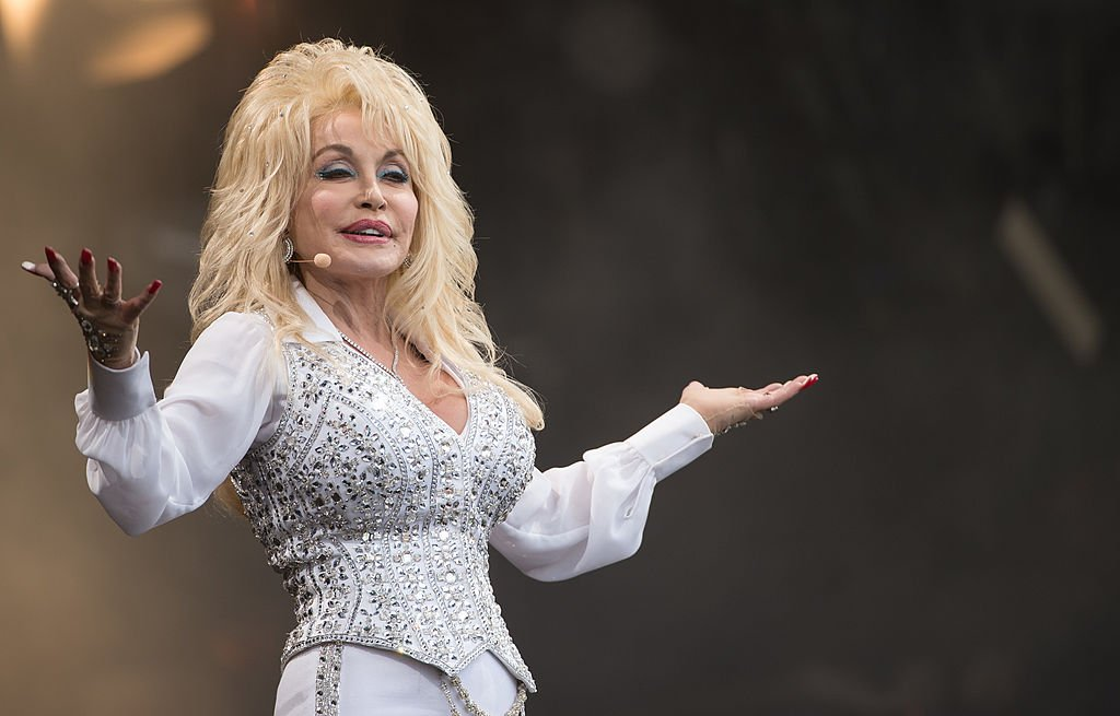 Image Credits: Getty Images / Ian Gavan | Dolly Parton performs on the Pyramid Stage during Day 3 of the Glastonbury Festival at Worthy Farm on June 29, 2014 in Glastonbury, England.