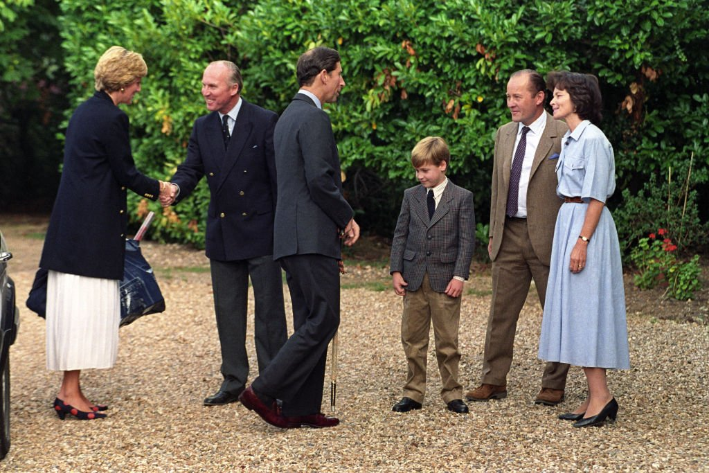 Image Credit: Getty Images / Prince William is welcomed to Ludgrove Preparatory School near Wokingham, Berkshire by joint headmaster Nichol Marston and Janet Barber, wife of the other headmaster, Gerald Barber.