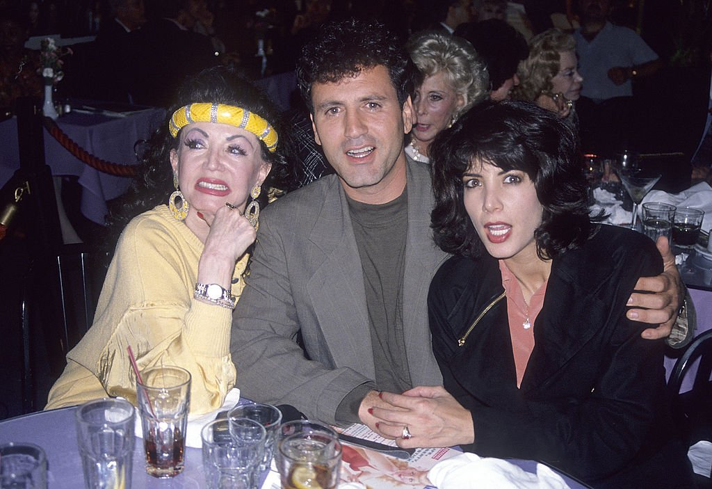 Image Credits: Getty Images / Ron Galella, Ltd. / Ron Galella Collection | Jackie Stallone, son Frank Stallone and daughter Toni-Ann Filiti attend Party to Celebrate Joe Franklin's Nostalgia Magazine's September 1990 Issue on August 16, 1990 at Ciro's Pomodor Restaurant in West Hollywood, California.