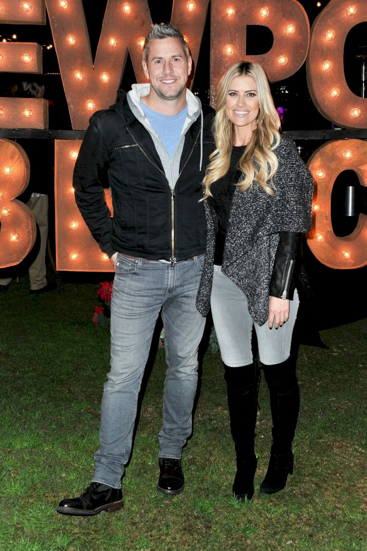 Image Credit: Getty Images/Allen Berezovsky | Grand Marshal Christina Anstead and Ant Anstead attend the 111th Annual Newport Beach Christmas Boat Parade opening night at Marina Park