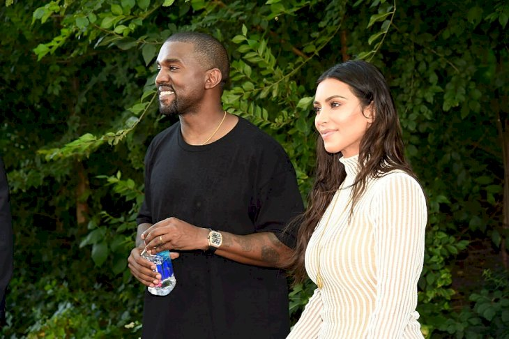 Image Credit: Getty Images / Kanye West and Kim Kardashian at the Yeezy show.