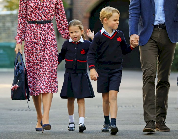 Image Credit: Getty Images / rincess Charlotte, waves as she arrives for her first day at school, with her brother Prince George and her parents.