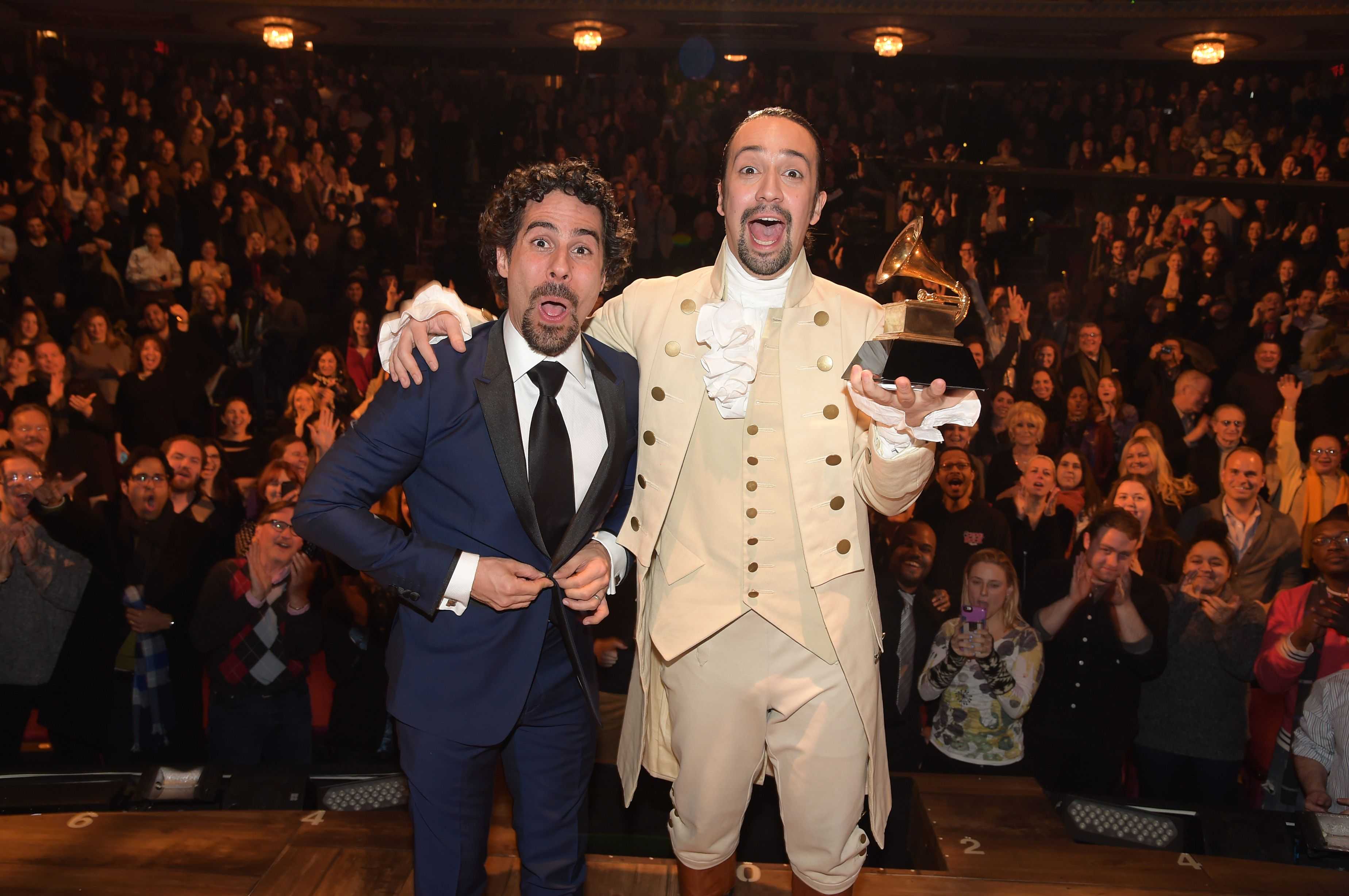 """Music director Alex Lacamoire and Actor, composer Lin-Manuel Miranda celebrate on stage during """"Hamilton"""" GRAMMY performance / Getty Images"""