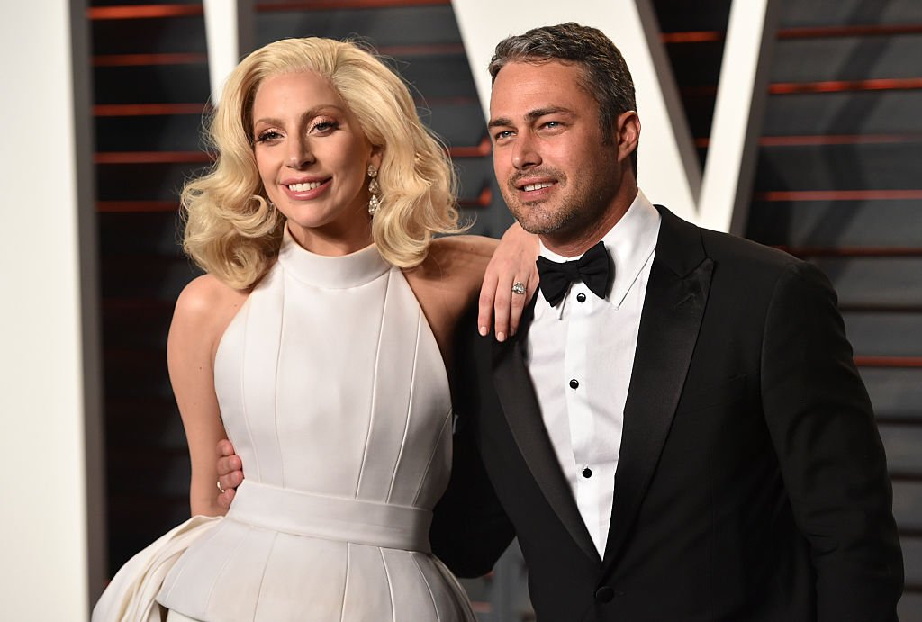 Image Source: Getty Images/John Shearer/Recording artist Lady Gaga (L) and Taylor Kinney arrive at the 2016 Vanity Fair Oscar Party Hosted By Graydon Carter at Wallis Annenberg Center for the Performing Arts on February 28, 2016