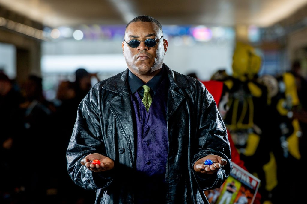 Image Credits: Getty Images / Roy Rochlin | A fan cosplays as Morpheus from The Matrix during the 2018 New York Comic-Con at Javits Center on October 7, 2018 in New York City.