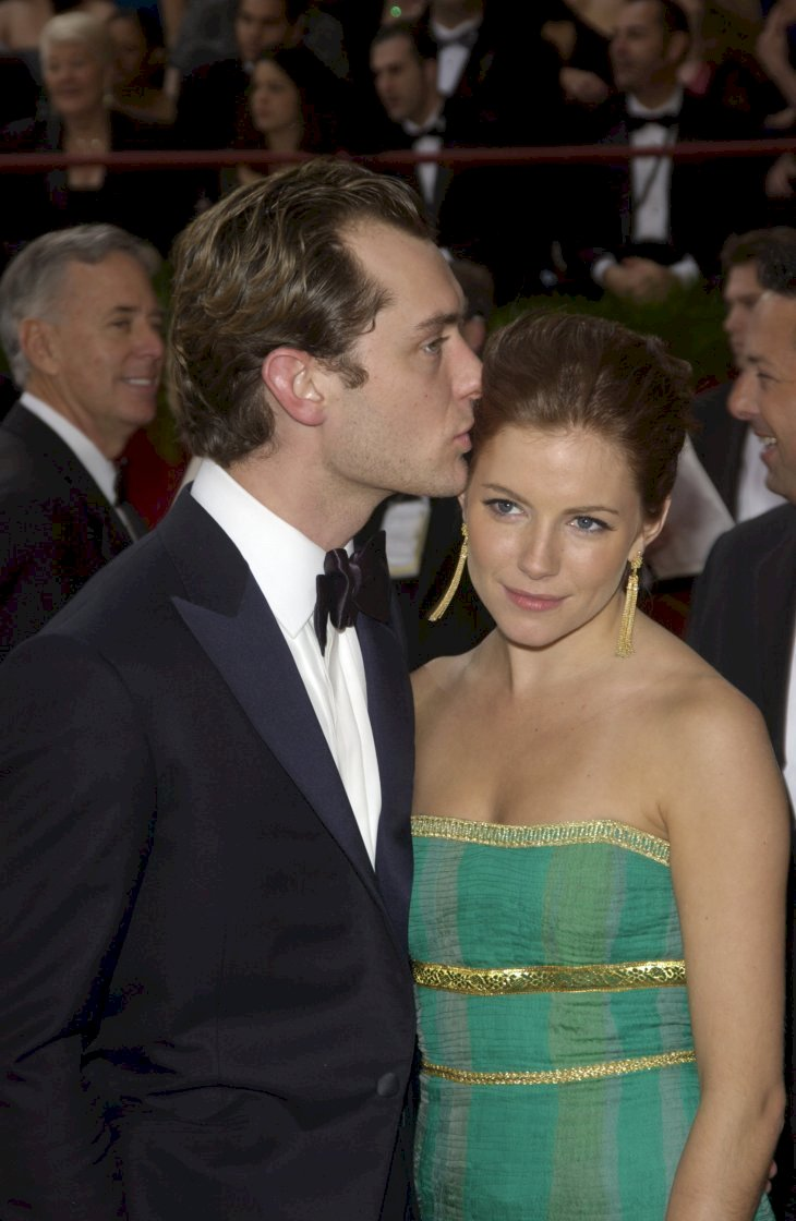 Image Credit: Shutterstock.com/Featureflash Photo Agency |JUDE LAW & SIENNA MILLER at the 76th Annual Academy Awards