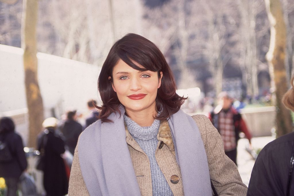 Image Source: Getty Images / Mark Rylewski | Circa 1995: Dutch-born model Helena Christensen walking outdoors and smiling (Bryant Park in New York City during New York Fashion Week)