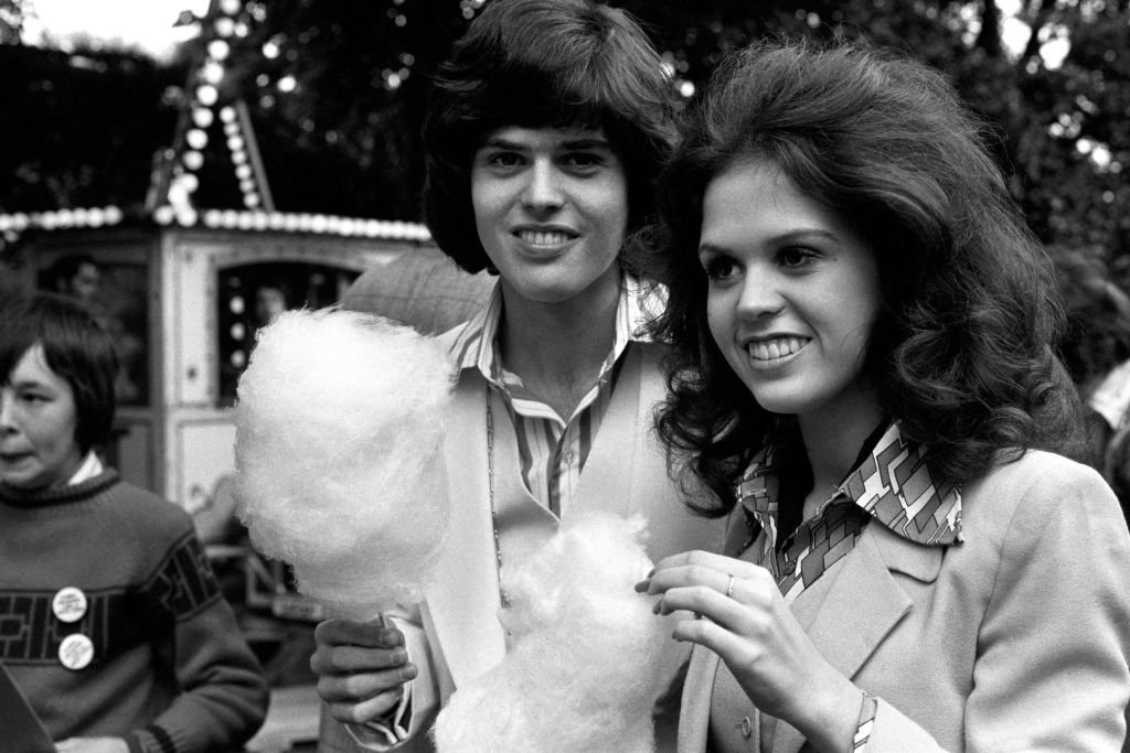 Image Credit: Getty Images / Marie Osmond with her brother Donny relaxing with candy floss at Richmond Fellowship in honour of the Osmonds group.