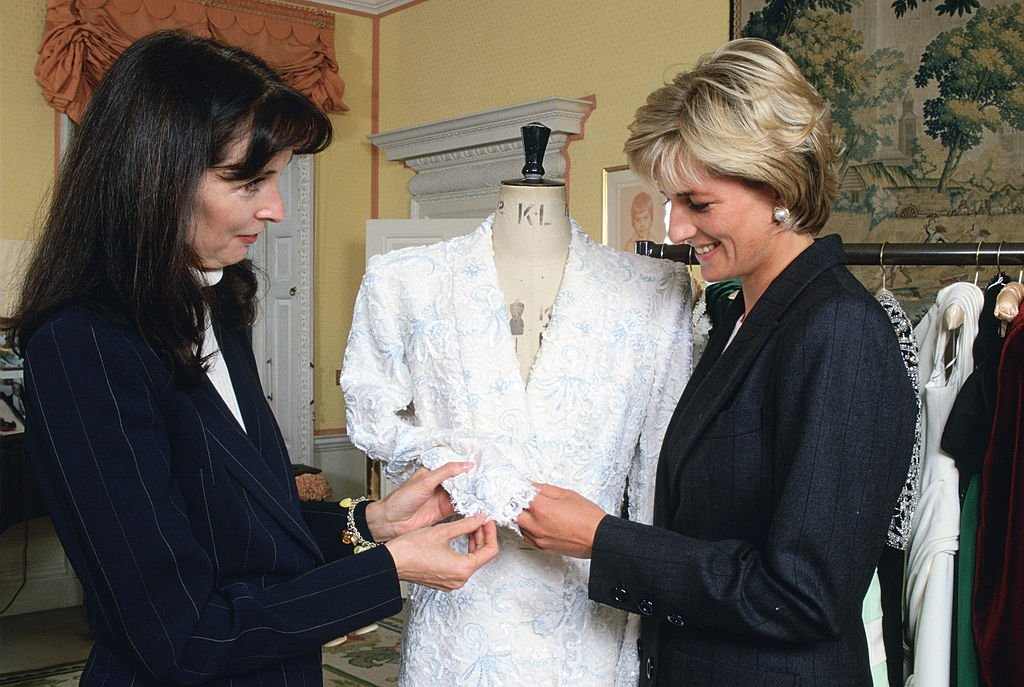 Image Credits: Getty Images/Tim Graham Photo Library/Tim Graham | Diana picking out dresses in the 80s