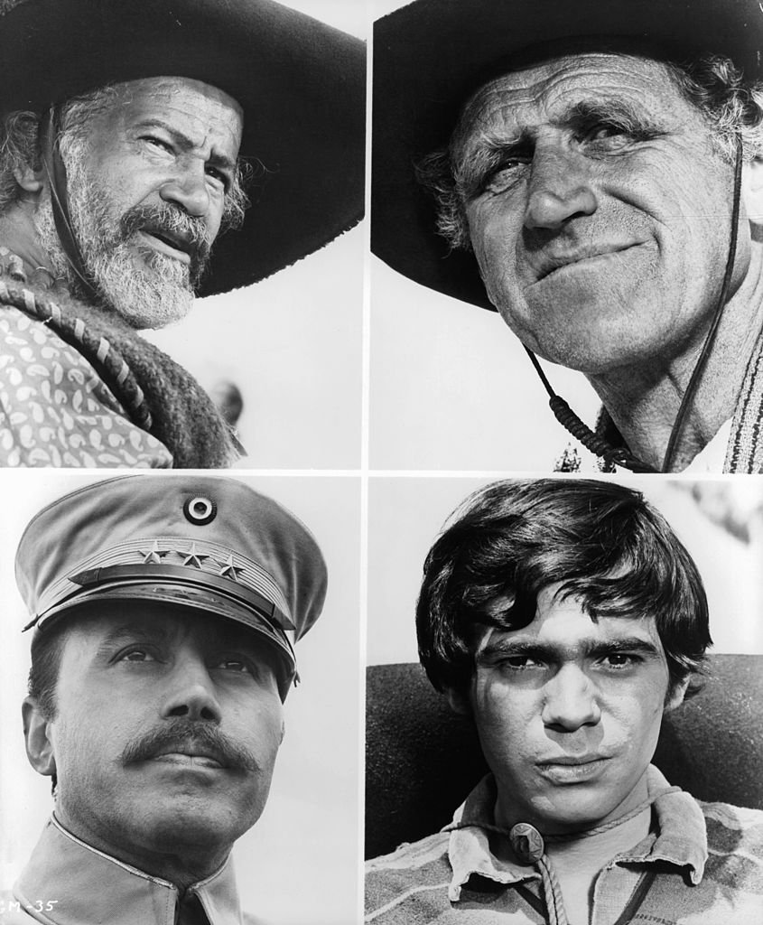 Image Credits: Getty Images / United Artists | Four faces, Frank Silver, James Whitmore, Michael Ansara and Reni Santoni in a scene from the film 'Guns Of The Magnificent Seven', 1969.