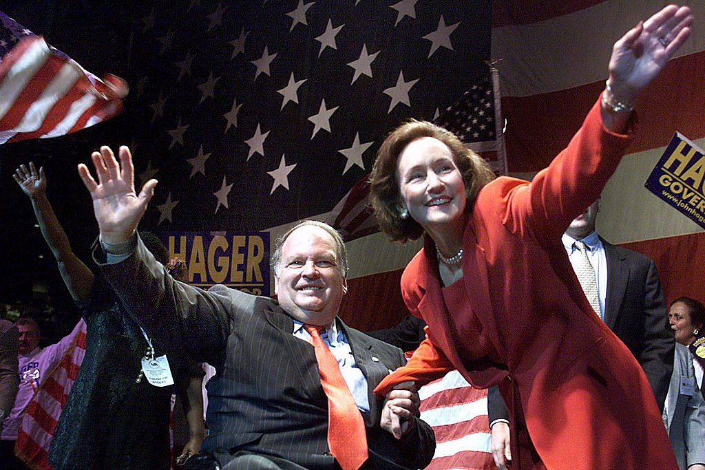 Image Credits: Getty Images / Rich Lipski / The Washington Post | Lt. Gov. John Hager and wife, Maggie, wave to supporters as his name was placed into nomination for governor of Virginia.