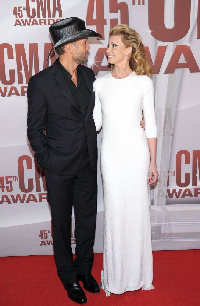 Image Credits: Getty Images / Michael Loccisano | Tim McGraw and Faith Hill attend the 45th annual CMA Awards at the Bridgestone Arena on November 9, 2011 in Nashville, Tennessee.