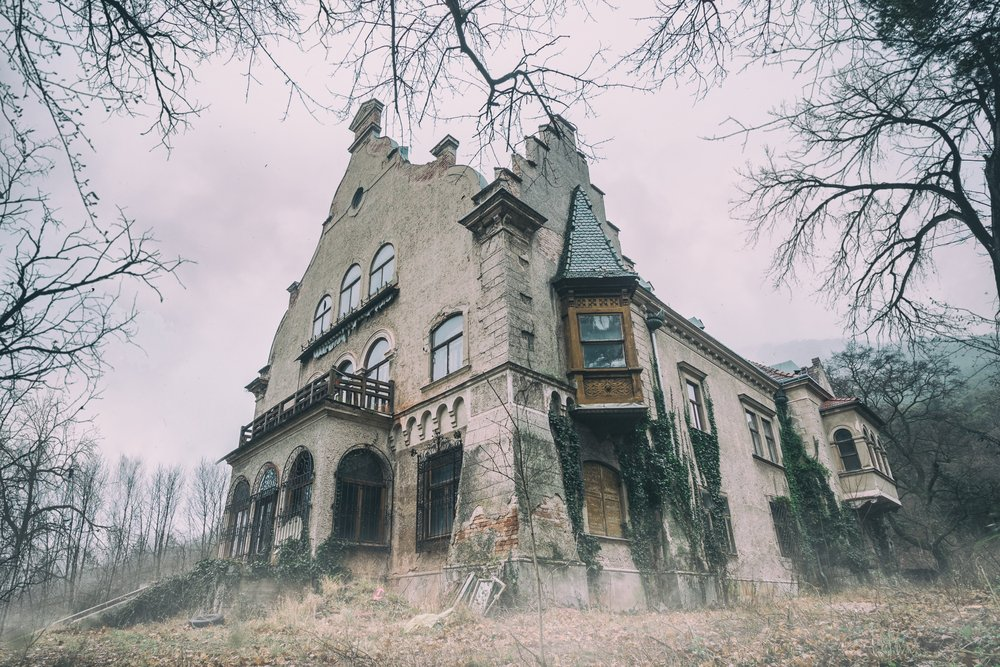 Old abandoned mansion in mystic spooky forest | Shutterstock