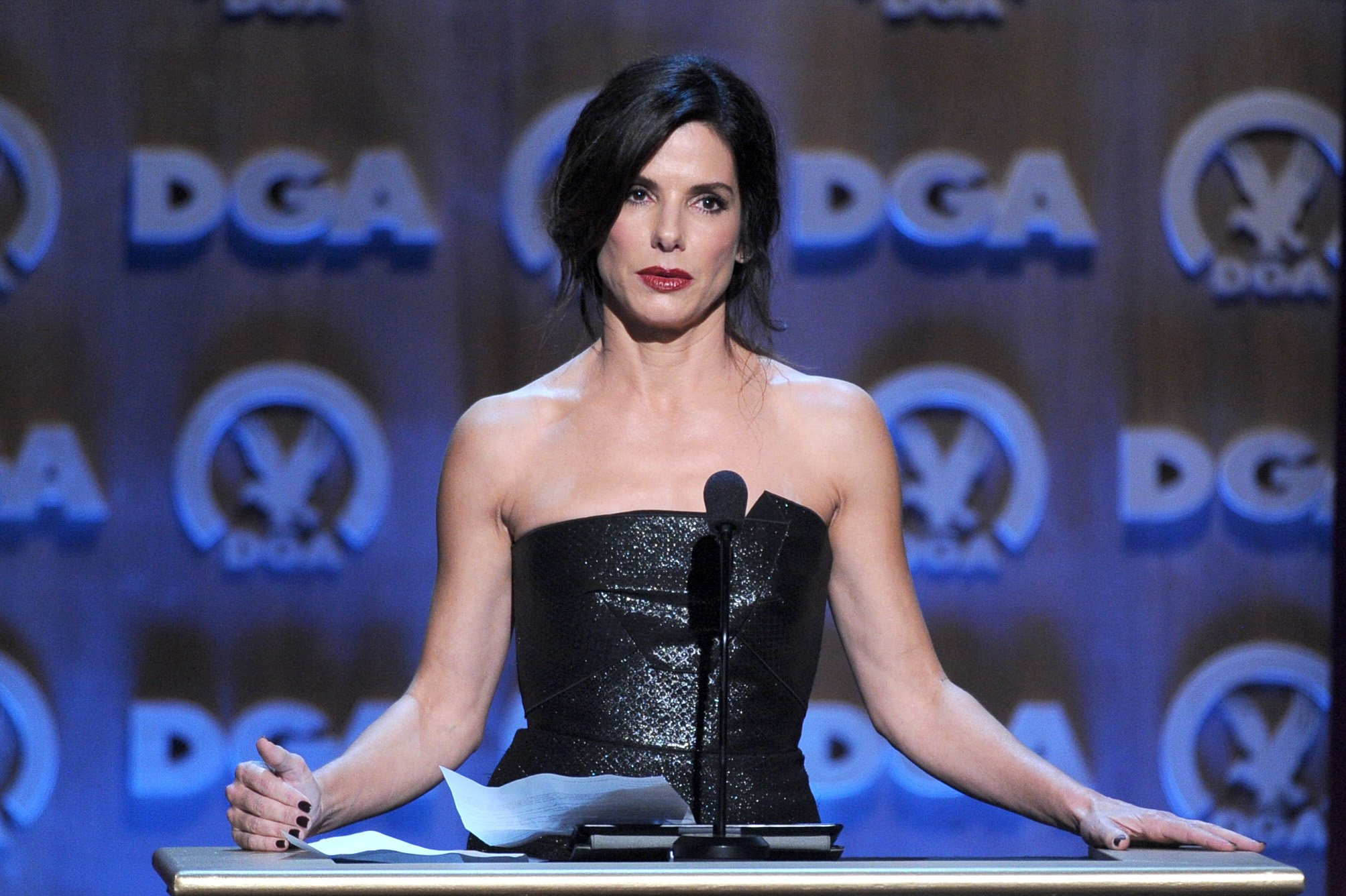Image Credits: Getty Images / Alberto E. Rodriguez | Actress Sandra Bullock speaks onstage at the 66th Annual Directors Guild Of America Awards held at the Hyatt Regency Century Plaza on January 25, 2014 in Century City, California.