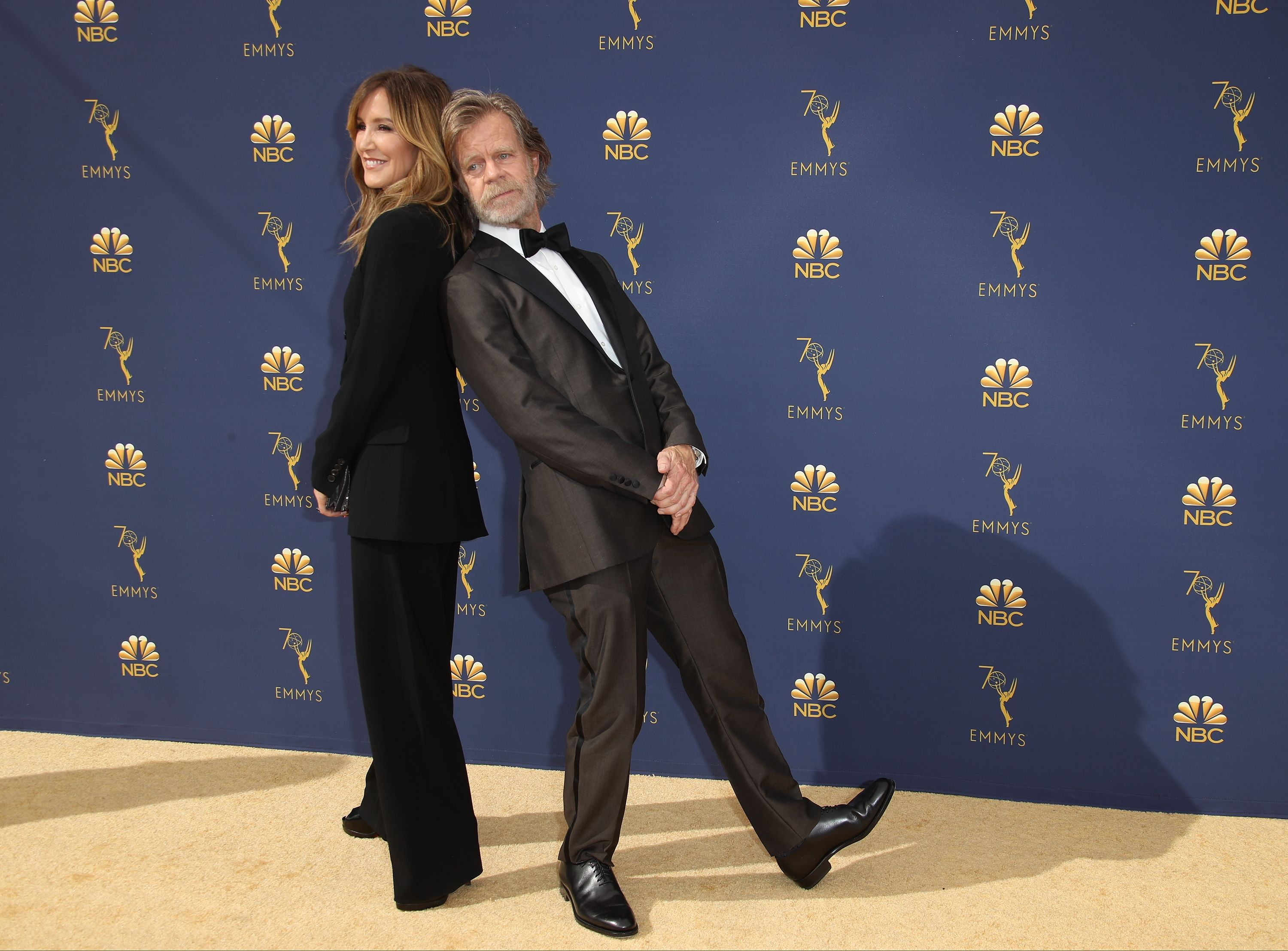 Felicity Huffman and William H. Macy attend the 70th Emmy Awards / Getty Images