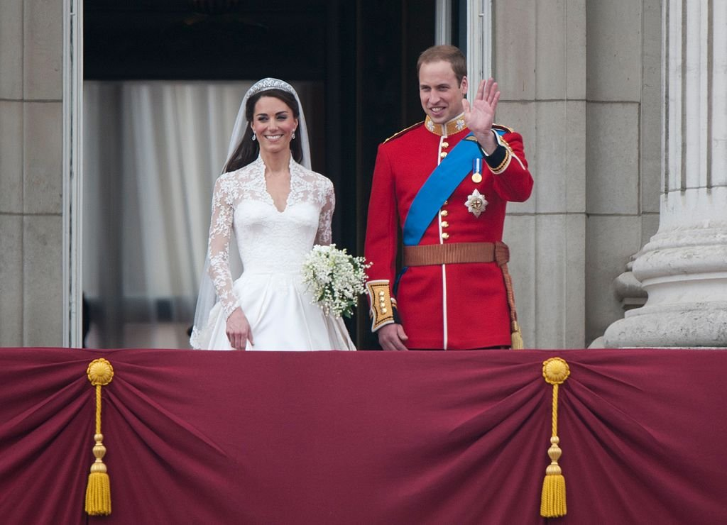 Image Credit: Getty Images / TRH Catherine, Duchess of Cambridge and Prince William, Duke of Cambridge on the balcony at Buckingham Palace, following their wedding at Westminster Abbey on April 29, 2011 in London, England.