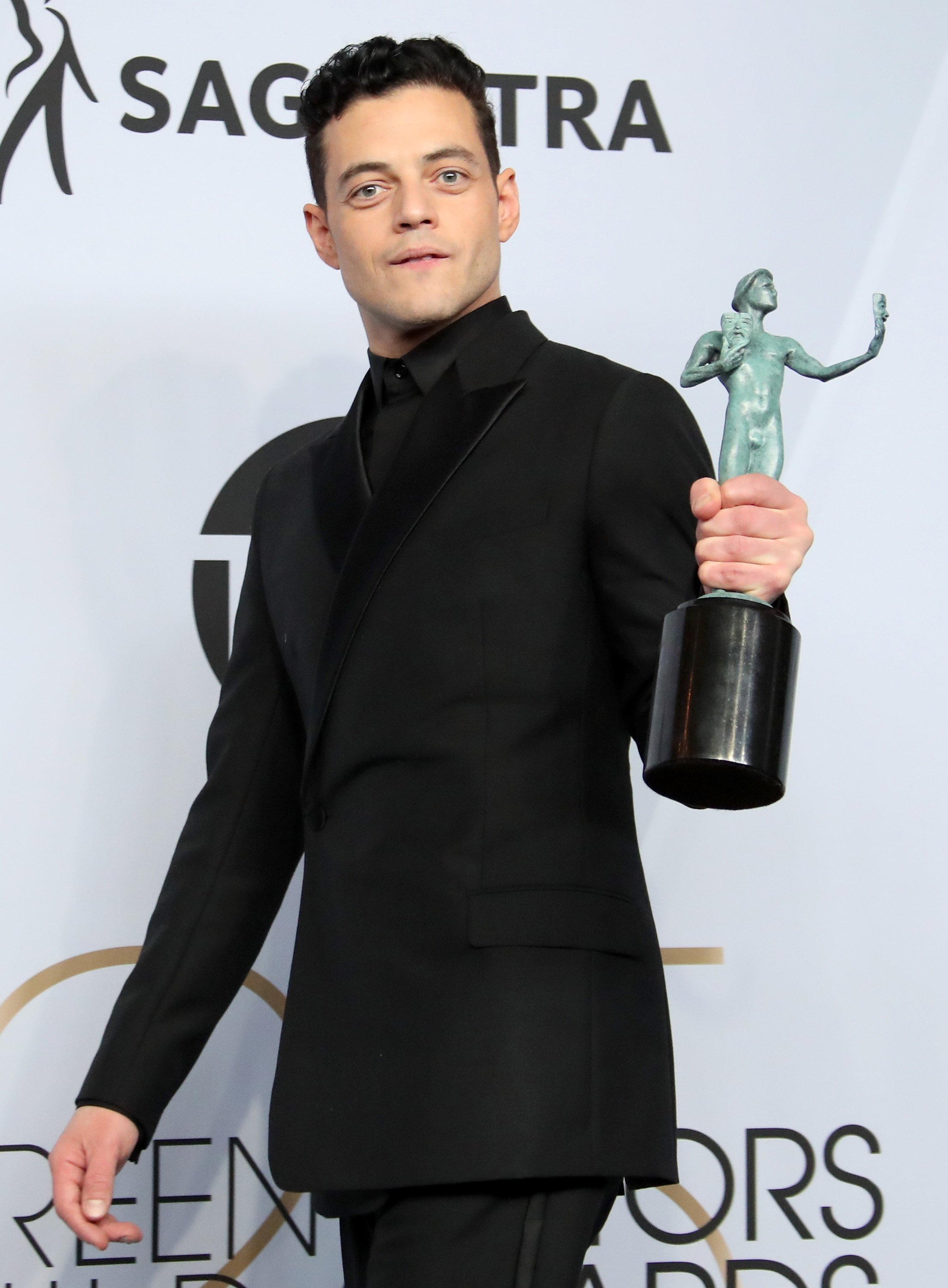 Image Credits: Getty Images / Dan MacMedan | Rami Malek, winner of Outstanding Performance by a Male Actor in a Leading Role in 'Bohemian Rhapsody,' poses in the press room during the 25th Annual Screen Actors Guild Awards at The Shrine Auditorium on January 27, 2019 in Los Angeles, California.