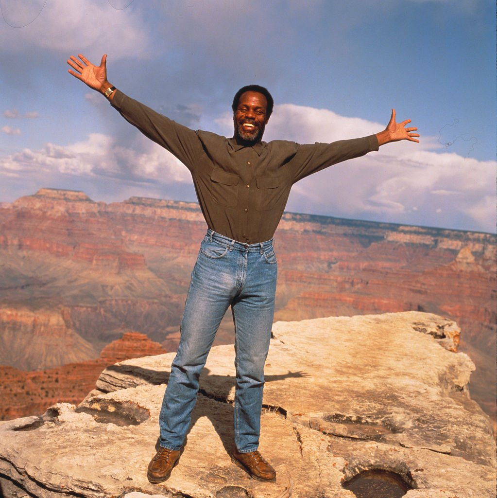 Image Source: Getty Images/Gary Moss| Danny Glover Standing on the Rim of the Grand Canyon