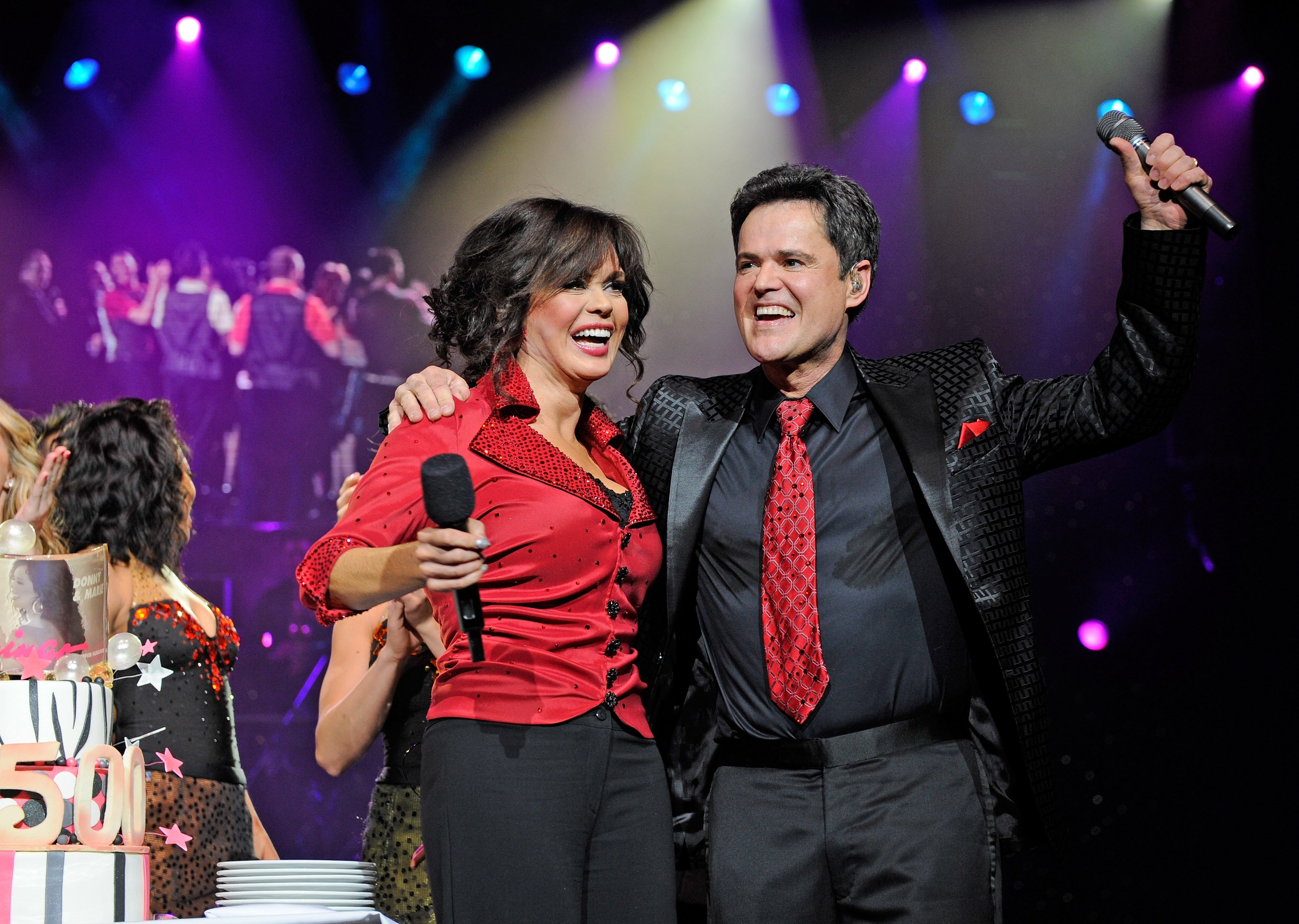 Image Credits: Getty Images / David Becker | Singers Marie Osmond and Donny Osmond celebrate after being presented a cake at the conclusion of their 500th Donnie & Marie variety show at the Flamingo Las Vegas March 23, 2011 in Las Vegas, Nevada.