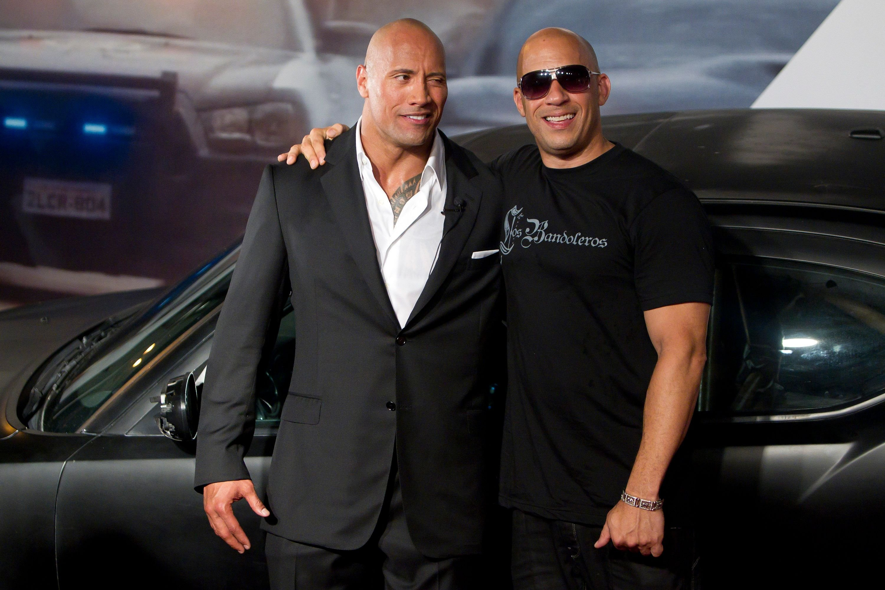 "Dwayne Johnson and Vin Diesel at the premiere of the movie ""Fast and Furious 5"" / Getty Images"