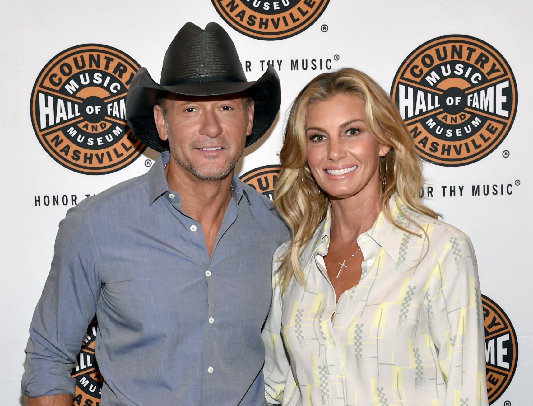 Image Credits: Getty Images / John Shearer | Tim McGraw (L) and Faith Hill (R) attend the All Access program at The Country Music Hall Of Fame And Museum's CMA Theater on May 3, 2018 in Nashville, Tennessee.