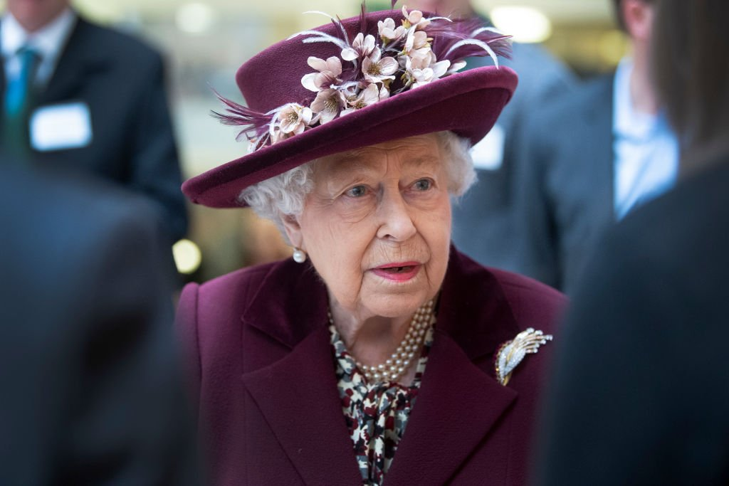 Image Credit: Getty Images / Queen Elizabeth II talks with MI5 officers during a visit to the headquarters of MI5 at Thames House on February 25, 2020 in London, England.