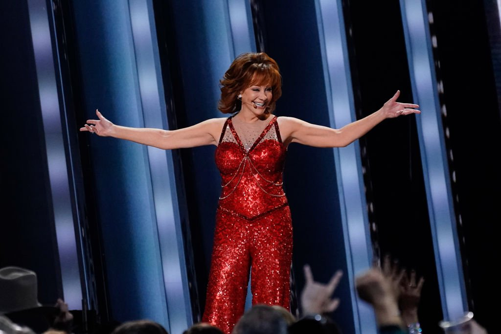Image Credit: Getty Images / Reba McEntire performs onstage at the 53rd annual CMA Awards at the Bridgestone Arena on November 13, 2019 in Nashville, Tennessee.