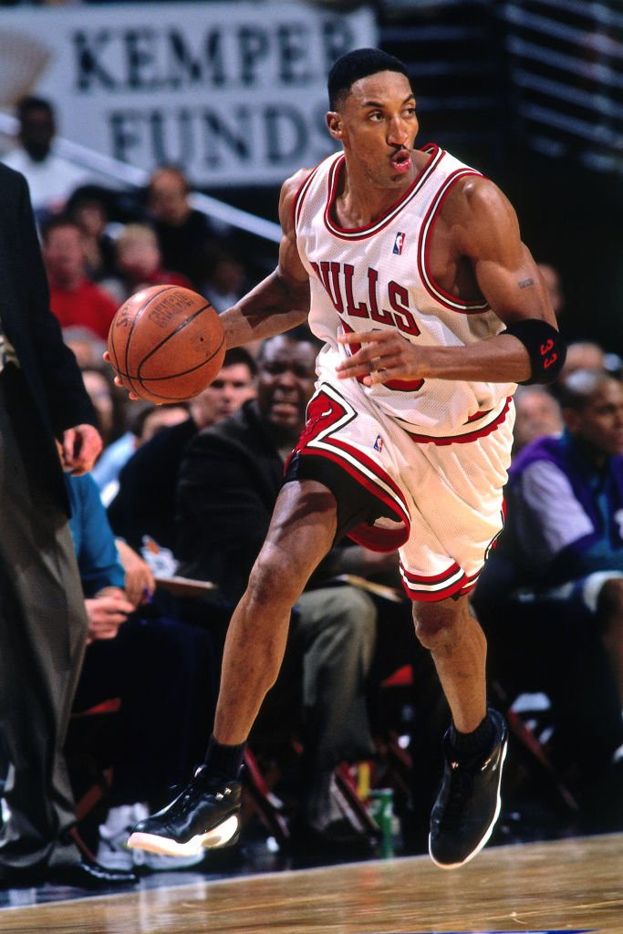Image Credits: Getty Images / Scott Cunningham / NBAE | Scottie Pippen #33 of the Chicago Bulls handles the ball against the Charlotte Hornets on May 3, 1998 at the United Center in Chicago, Illinois.