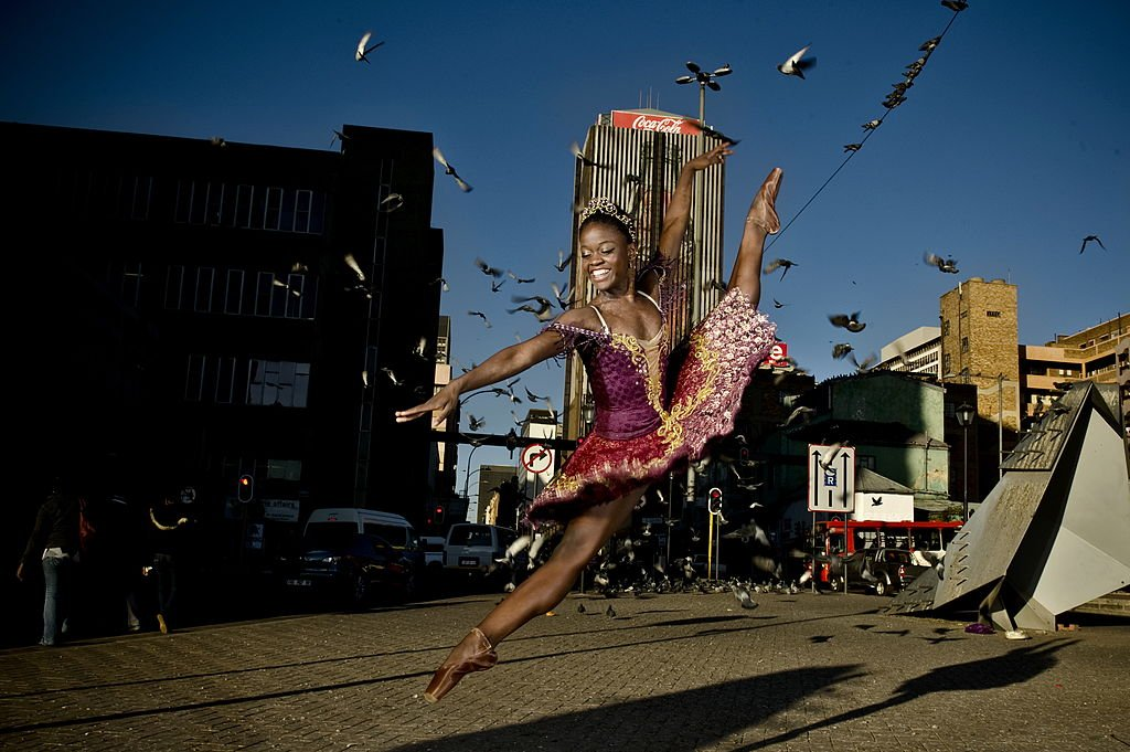 Image Credits: Getty Images / Herman Verwey / City Press / Gallo Images   Ballet dancer Michaela DePrince poses on July 12, 2012 in Johannesburg, South Africa. DePrince is in South Africa to perform her first professional full ballet role as the lead in 'Le Corsaire.' DePrince, who was born in Sierra Leone, escaped the civil war and was adopted by a family in the U.S.