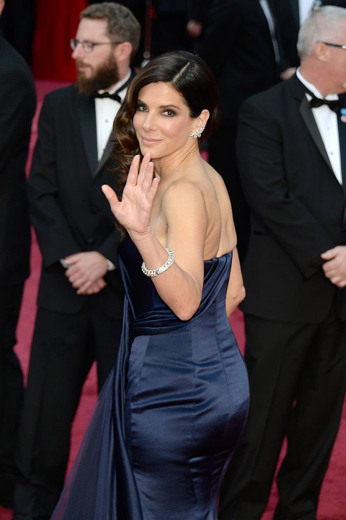 Image Credits: Getty Images / Kevork Djansezian | Actress Sandra Bullock attends the Oscars held at Hollywood & Highland Center on March 2, 2014 in Hollywood, California.