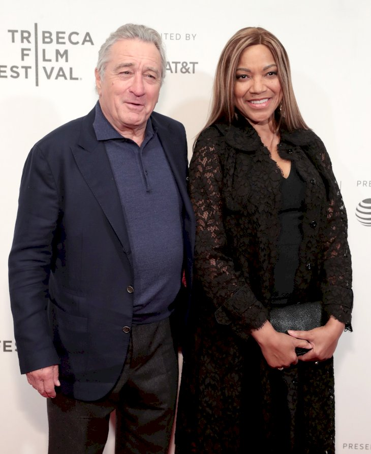 Image Credits: Getty Images / Cindy Ord | Robert De Niro and Grace Hightower attend Showtime's World Premiere of The Fourth Estate at Tribeca Film Festival Screening at BMCC Tribeca Performing Arts Center on April 28, 2018 in New York City.