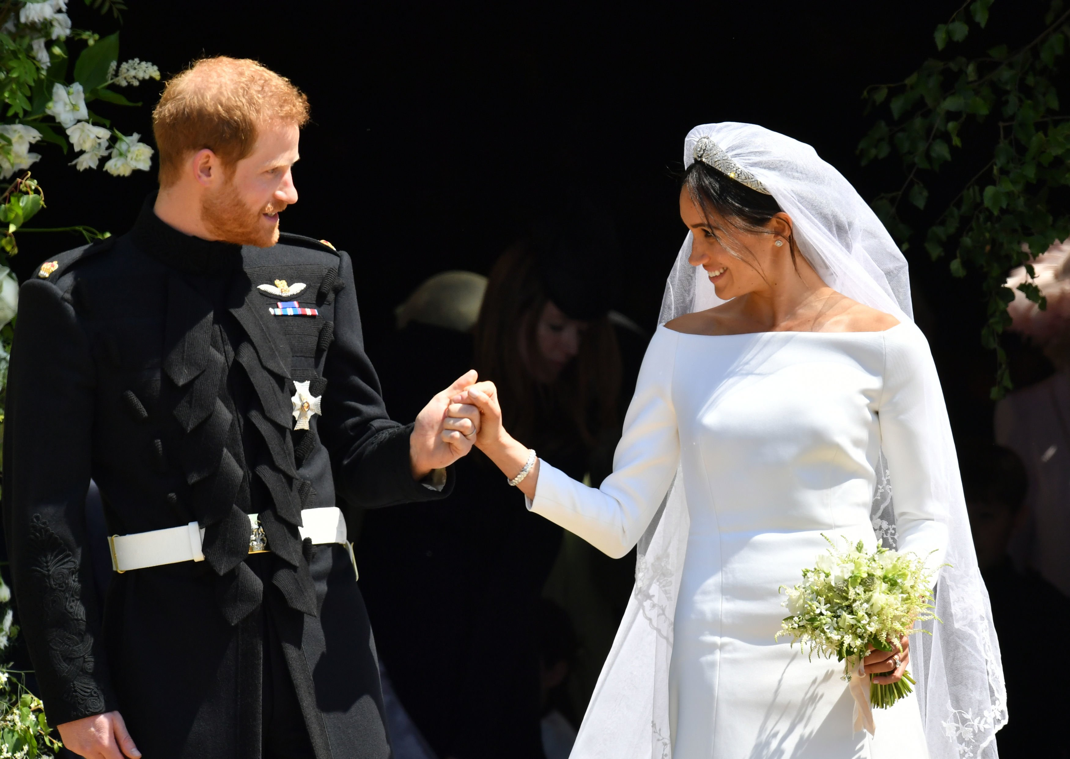 Image Credits: Getty Images / Ben Birchall - WPA Pool   Prince Harry and Meghan Markle leave St George's Chapel through the west door after their wedding in St George's Chapel at Windsor Castle on May 19, 2018 in Windsor, England.