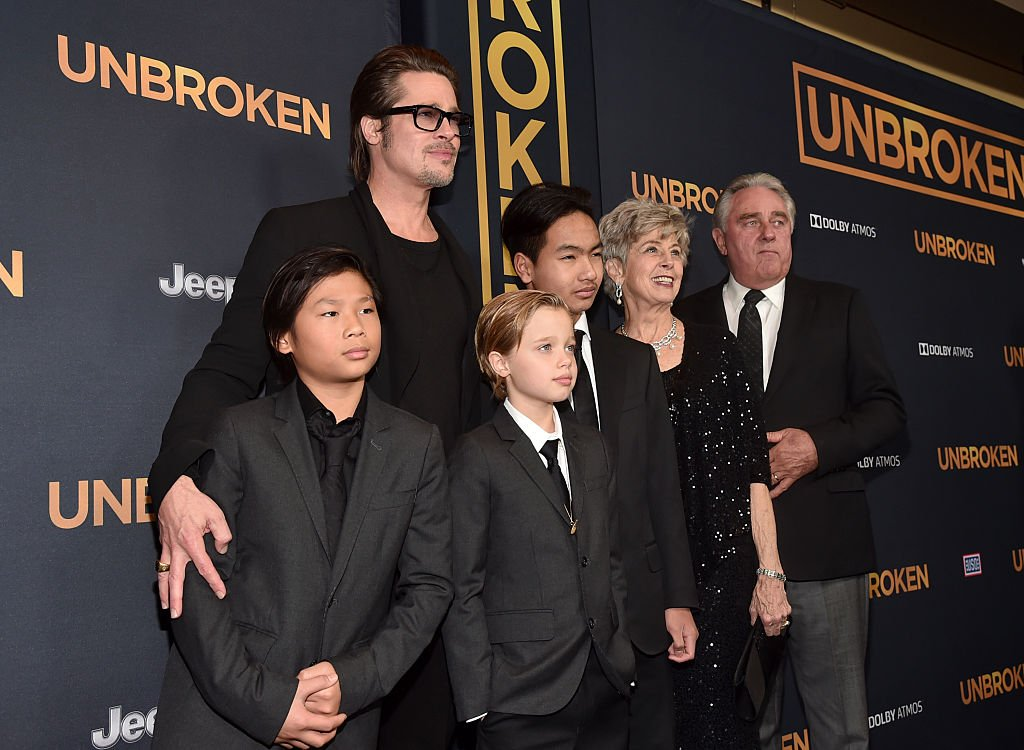 Image Source: Getty Images/ Brad with the kids at a movie event