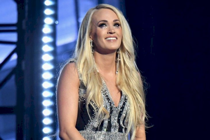 Image Source: Getty Images/FilmMagic for ACM/ACMA2018/Jeff Kravitz | Carrie Underwood performs onstage during the 53rd Academy of Country Music Awards