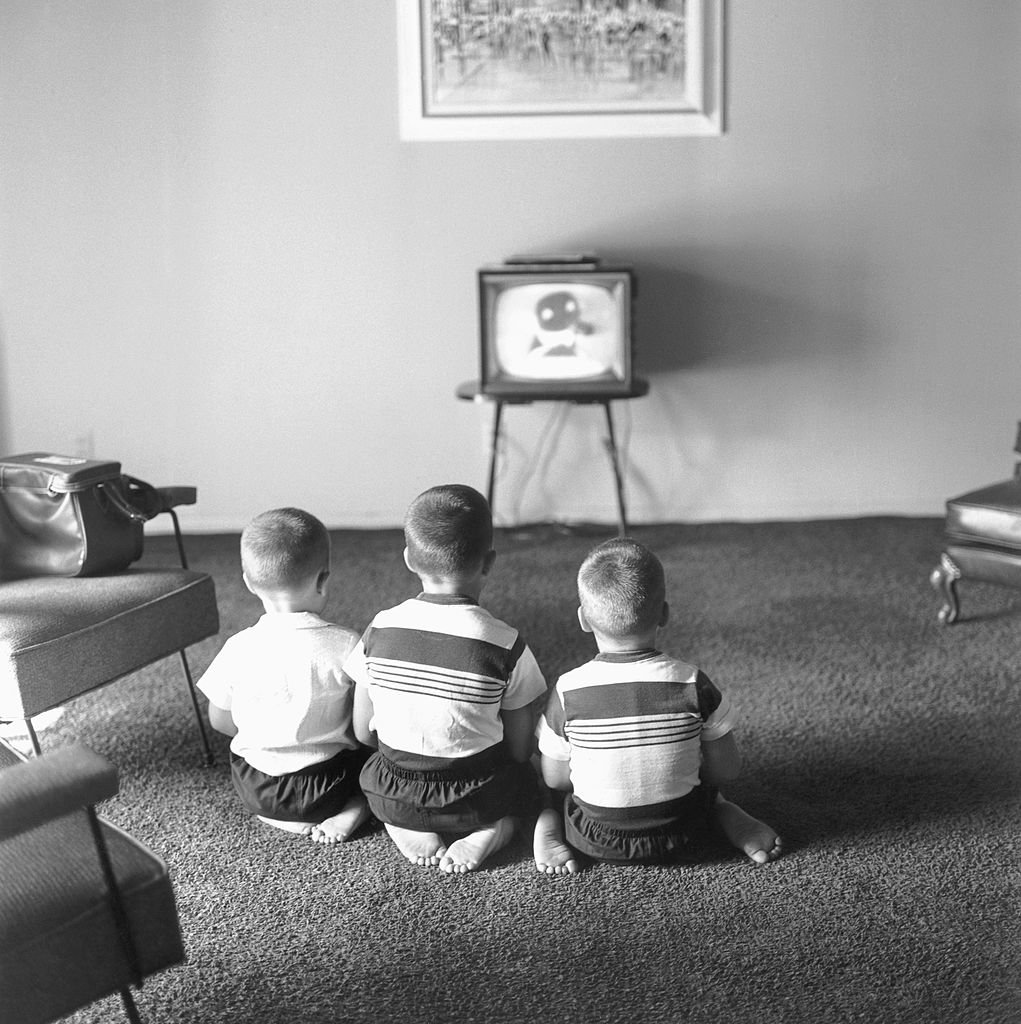 Image Credits: Getty Images / Michael Ochs Archives | Johnny's three sons watching TV at home, L-R: Cory, Christopher, Richard.
