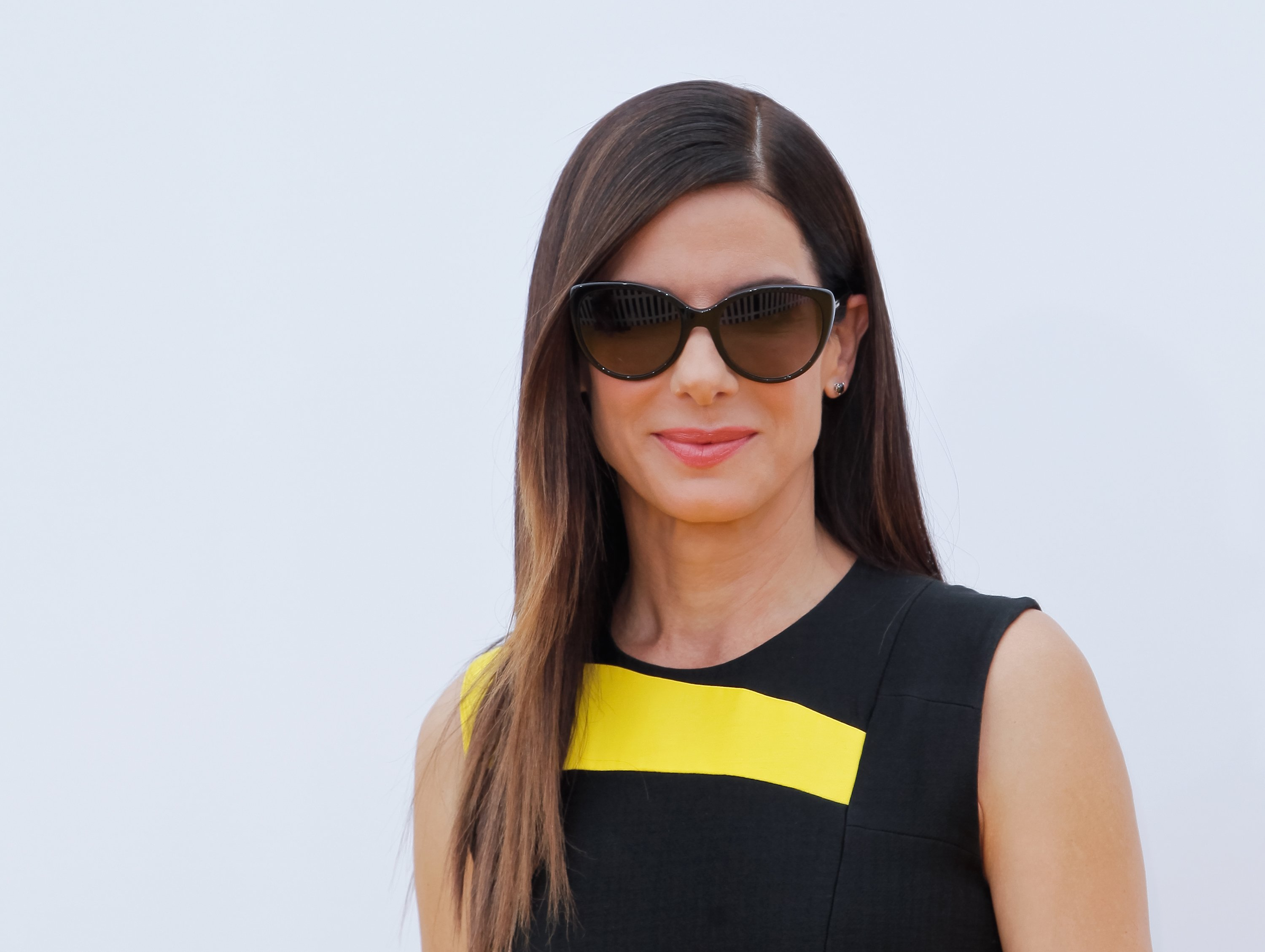 Image Credits: Getty Images / Tibrina Hobson | Sandra Bullock attends the Premiere of 'Minions' at The Shrine Auditorium on June 27, 2015 in Los Angeles, California.