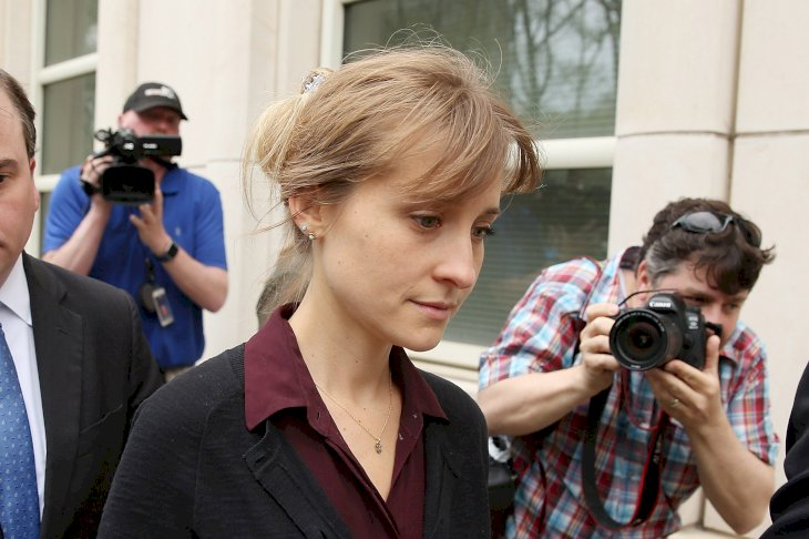 Image Credits: Getty Images / Jemal Countess | Actress Allison Mack (C) departs the United States Eastern District Court after a bail hearing in relation to charges filed against her on May 4, 2018.